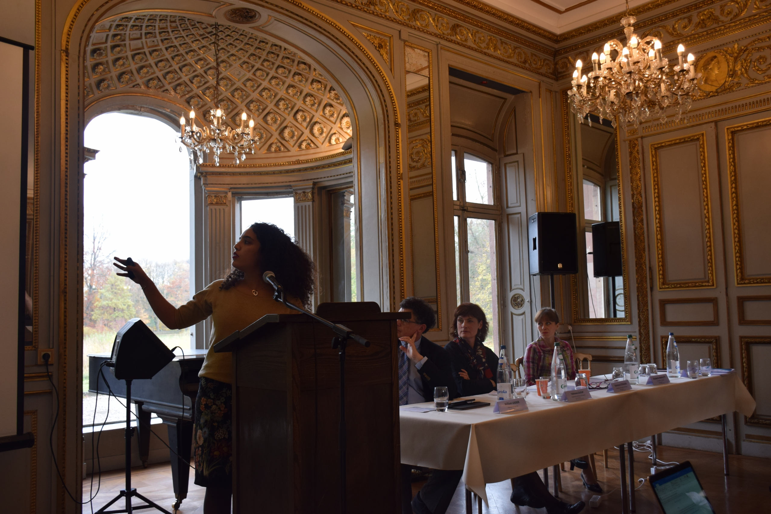 Student giving a presentation at the Chateau de Pourtales Castle Talks Symposium at the European Study Center in Strasbourg, France